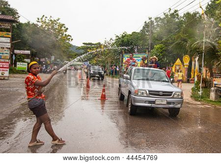 KO CHANG, THAILAND - APR 13: People celebrate Songkran Festival, on 13 Apr 2013 on Ko Chang, Thailand. Songkran is celebrated in Thailand as the traditional New Year by throwing water at each other.