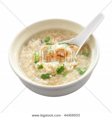 Congee round bowl and spoon on white background.