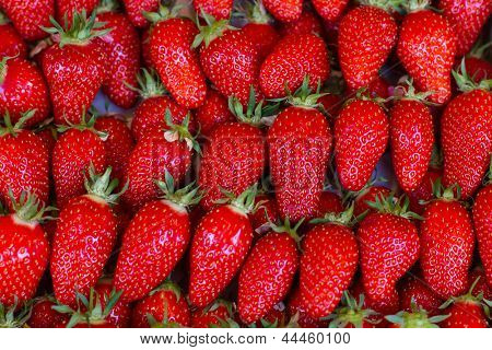 close up of strawberry on market stand