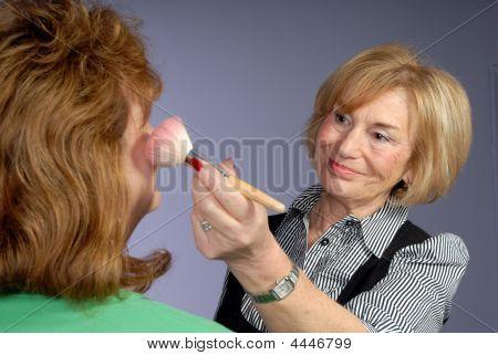 Attractive Mature Lady Make Up Artist Applies Blusher