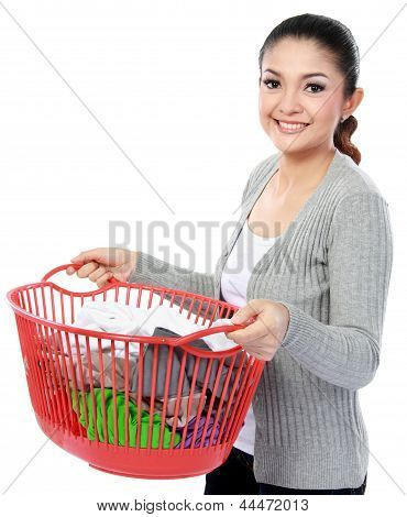 Happy Asian Woman With A Basket Of Loundry