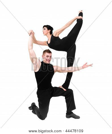two young modern acrobats posing on white
