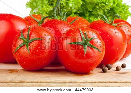 Fresh Wet Tomatoes, Allspice And Lettuce On A Cutting Board Wooden Isolated On White Background