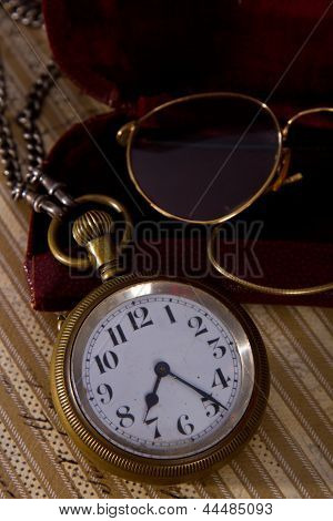 Pocket Watch And Glasses