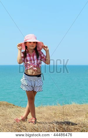Girl Holds On To Her Hat