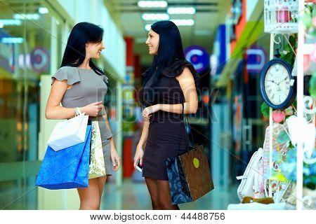 Happy Elegant Women Shopping In City Mall
