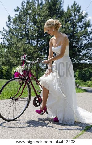 Bride In Purple Shoes On The Bicycle