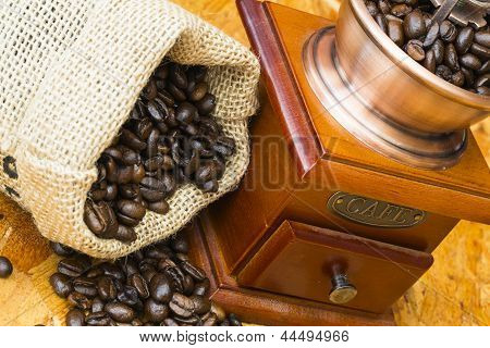 Fresh Roasted Coffee Beans And Old Coffee Grinder