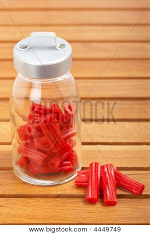 Red Licorice On Glass Jar