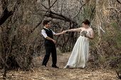 foto of same sex  - Married same sex couple dancing in the forest together - JPG