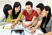 picture of handphone  - Group of asian students looking at handphone together - JPG
