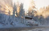 stock photo of nea  - Hut nea water and misty forest in winter in Lapland Finland - JPG