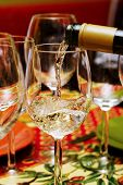 picture of wine-glass  - Pouring a white wine into the glass - JPG