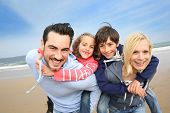 stock photo of 7-year-old  - Portrait of cheerful family at the beach - JPG