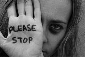 stock photo of abused  - stop violence against woman and children - JPG