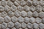 Texture Of A Wall With Stones And Masonry Shaped Of Hexagons