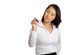 stock photo of sharpie  - Formal Asian Business woman writing with pen - JPG
