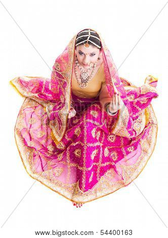 Bollywood dancer in traditional beautiful pink wedding dress