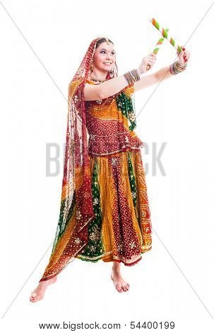 Bollywood dancer in traditional beautiful orange dress with veil and sticks