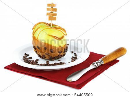 Homemade taffy apple on color napkin, isolated on white
