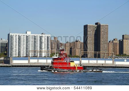 Tugboat Evening Mist in East River in New York