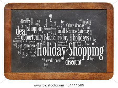 consumerism concept - holiday shopping word cloud  on a  vintage slate blackboard isolated on white