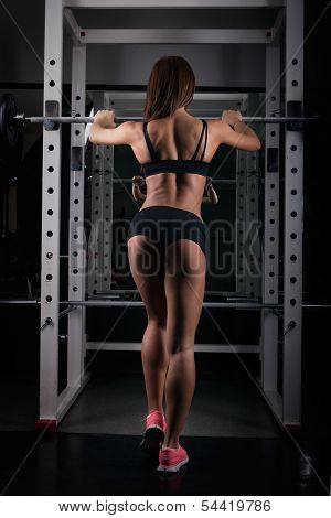Fitness-female Lifting Weights-rear View