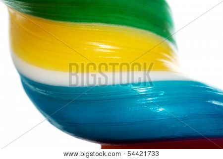 Close up on one longitudinal and colorful lollipop.