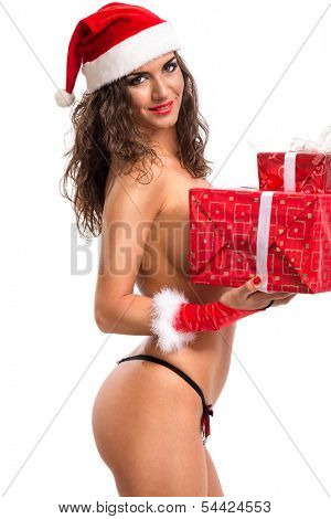 Beautiful nude Christmas woman in santa hat with gift box