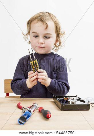 Child Choosing Tool For Repairing Hard Drive