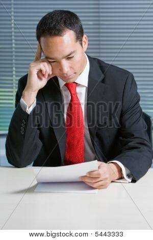 Smart Eurasian Business Man Browsing Documents