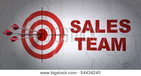 Advertising concept: target and Sales Team on wall background