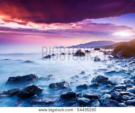 Majestic summer sunset over the sea. Dramatic overcast sky with colorful cloud. Crimea, Ukraine, Europe. Beauty world.
