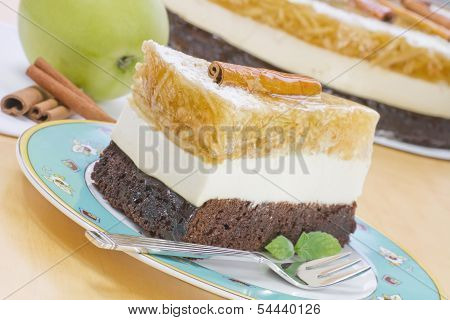 A Piece Of Apple Cake On A Plate