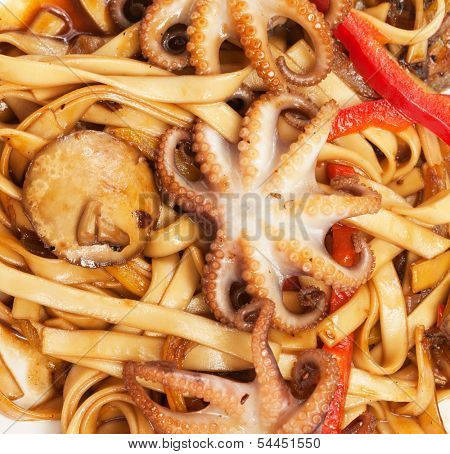noodles with octopuses, seafood and sauce