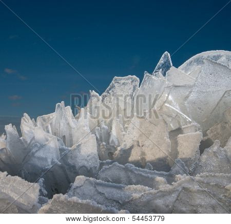 Sharp pieces of ice against blue sky