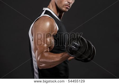 Muscle man in studio lifting weights, isolated over a white background