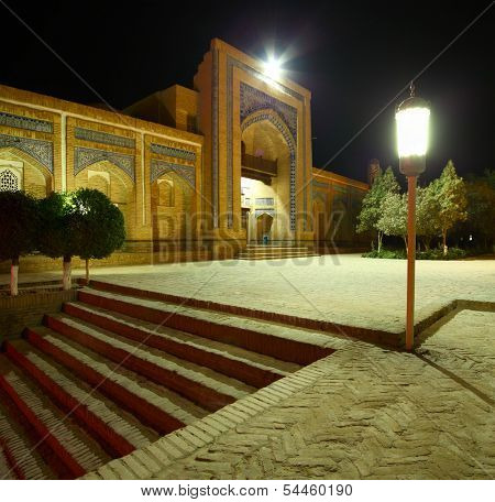 Oriental building with trees in the yard at night.The city of Khiva, Uzbekistan
