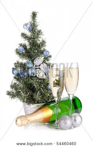 Champagne, firtree and christmas decor. Isolated on white background