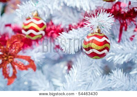 Christmas red balls and decorations on white Christmas tree