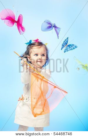 Curious little girl holding butterfly net in hands