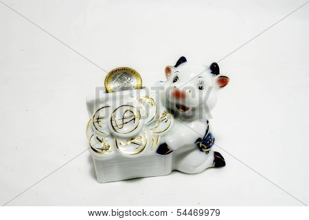 Statuette of a cow with a coin