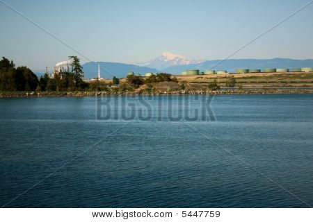 Oil Refinery And Mount Baker On Puget Sound