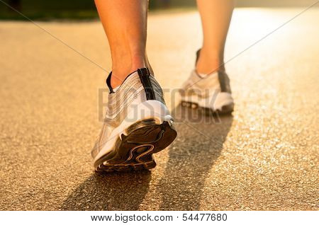 Closeup Of Athlete's Feet Running On Road
