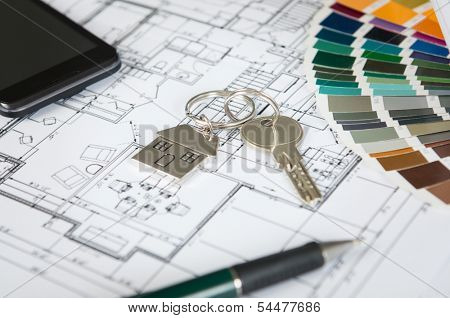 Close Up Of A House Key On Blueprint And Color Palette
