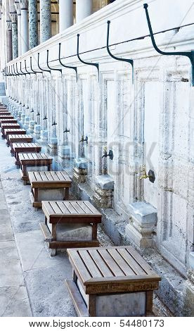 Taps and stools outside Mosque