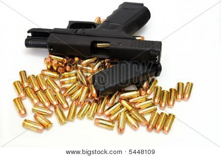 Black Handgun And Bullets