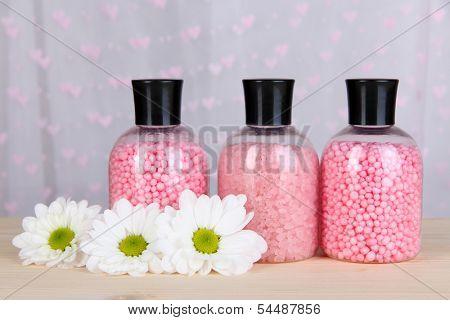Aromatherapy minerals - colorful bath salt on light background