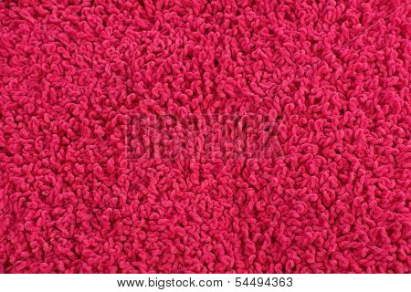 Fleecy pink pillow close-up background