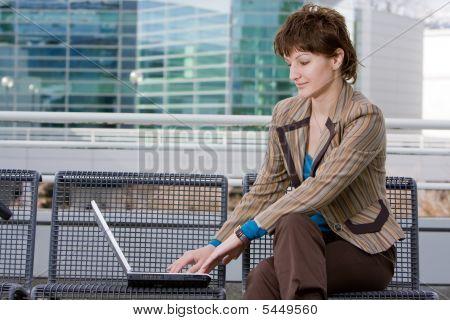 Beautiful Brunette Woman On Computer